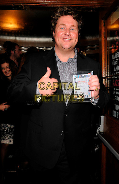 MICHAEL BALL.The What's On Stage: Year On Year Concert, Lyric Theatre, London, England..February 24th, 2008.half length black suit 3/4 award trophy winner best actor in a musical hand thumb up.CAP/CAN.©Can Nguyen/Capital Pictures.