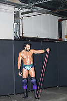 "WWE Champion Jinder Mahal exercises backstage before a match at a WWE Live Summerslam Heatwave Tour event at the MassMutual Center in Springfield, Massachusetts, USA, on Mon., Aug. 14, 2017. Mahal uses the time immediately before his matches to get oiled up and to ""pump up"" his muscles using exercise bands."