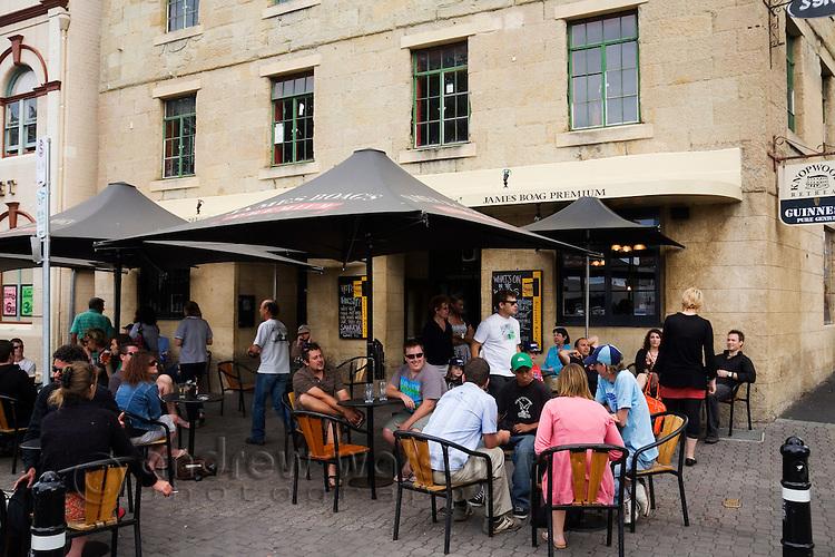 Enjoying a drink on the Hobart waterfront at Salamanca Place.  Hobart, Tasmania, AUSTRALIA