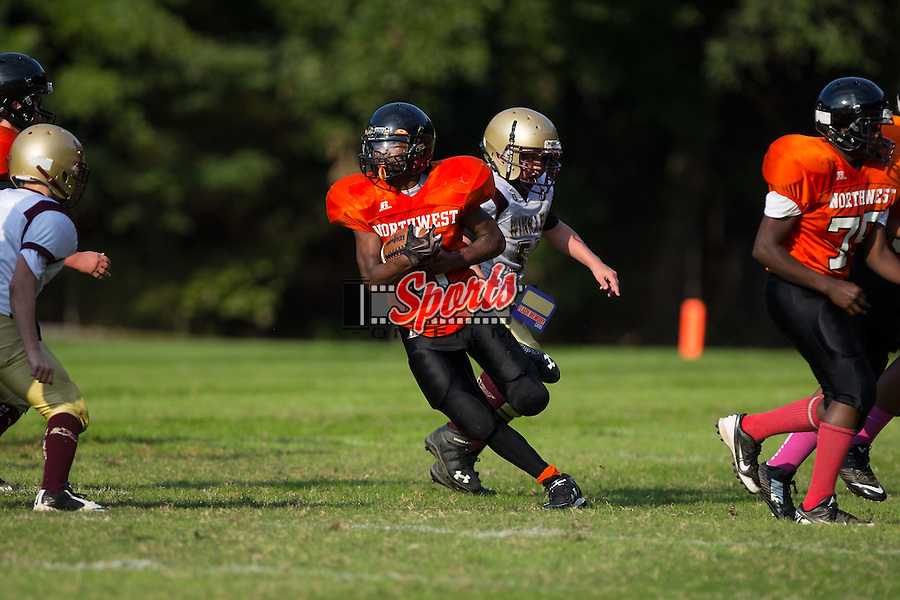 George Miller Duncan (3) of the Northwest Cabarrus Titans runs with the football during first half action against the Winkler Wolves at Trojan Stadium October 1, 2014, in Concord, North Carolina.  The Wolves defeated the Titans 24-22.  (Brian Westerholt/Sports On Film)