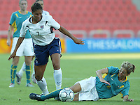 17 August 2004:   Shannon Boxx fights for the ball against Sally Shipard  at Kaftanzoglio Stadium in Thessaloniki, Greece.     USA tied Australia at 1-1.   Credit: Michael Pimentel / ISI