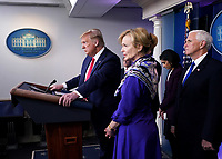 United States President Donald J. Trump delivers remarks on the COVID-19 (Coronavirus) pandemic alongside members of the Coronavirus Task Force in the Brady Press Briefing Room at the White House in Washington, DC, March 18, 2020, in Washington, D.C.  Looking on are Dr. Deborah L. Birx, White House Coronavirus Response Coordinator, center, and US Vice President Mike Pence, right.<br /> Credit: Kevin Dietsch / Pool via CNP/AdMedia