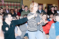 Terri Magnus, a Professor of Mathematics at Rivier University, asks a question about his position on the Common Core syllabus to Republican presidential candidate and former Florida governor Jeb Bush after he spoke at a town hall in Souhegan High School in Amherst, New Hampshire.