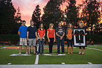 Occidental College teammates, coaches and friends gather to share stories about quarterback Andy Collins '06, who tragically passed away at age 27. The reception was held in the Dumke Commons room in the newly renovated Swan Hall, October 6, 2012. Andy's family was also in attendance and participated in a pregame ceremony in which his #1 jersey was retired.<br /> (Photo by Marc Campos, Oxy College Photographer)