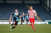 Garry Thompson of Wycombe Wanderers & Luke Wilkinson of Stevenage chases down the ball during the Sky Bet League 2 match between Wycombe Wanderers and Stevenage at Adams Park, High Wycombe, England on 12 March 2016. Photo by Andy Rowland/PRiME Media Images.