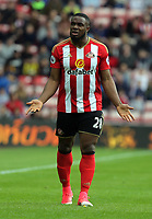 Victor Anichebe of Sunderland  (C) protests to the linesman for his foul against Kyle Naughton of Swansea City during the Premier League match between Sunderland and Swansea City at the Stadium of Light, Sunderland, England, UK. Saturday 13 May 2017