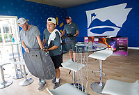 NWA Democrat-Gazette/JASON IVESTER<br /> Austin Comiskey (cq) (from left), Mike Vasquez and Drew Clark, all with Roark Group, set up a television stand Wednesday, June 14, 2017, in the seating area overlooking the 18th green at Pinnacle Country Club in Rogers. Events begin Monday for the LPGA Wal-Mart NW Arkansas Championship.