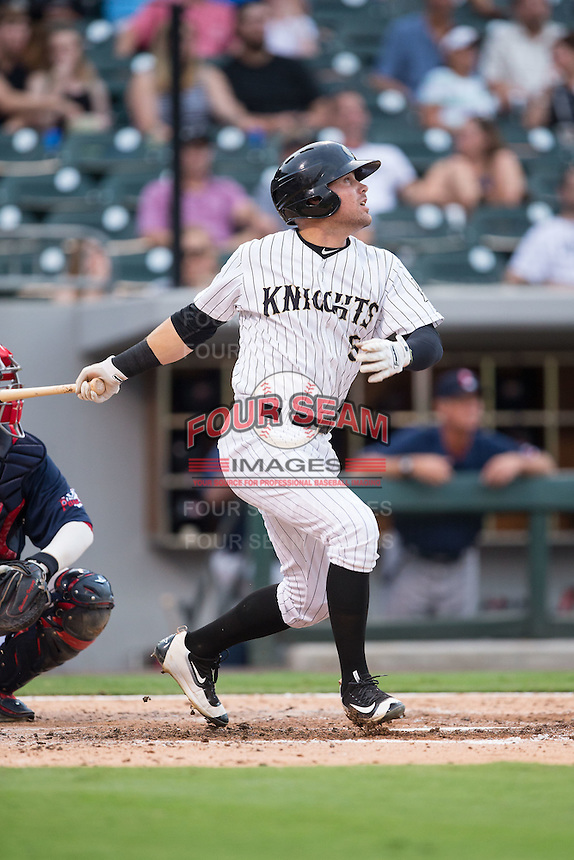 Jake Peter (5) of the Charlotte Knights follows through on his swing against the Pawtucket Red Sox at BB&T BallPark on July 6, 2016 in Charlotte, North Carolina.  The Knights defeated the Red Sox 8-6.  (Brian Westerholt/Four Seam Images)