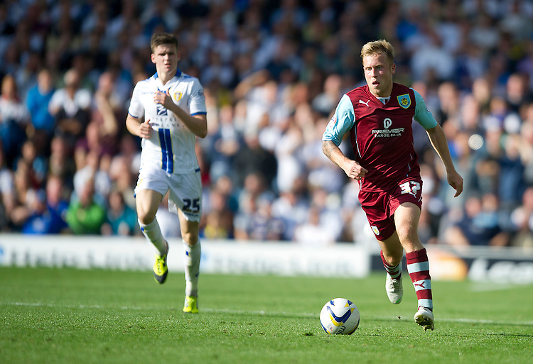 Burnley's Scott Arfield sets up another attack<br /> <br /> Photo by Stephen White/CameraSport<br /> <br /> Football - The Football League Sky Bet Championship - Leeds United v Burnley - Saturday 21st September 2013 - Elland Road - Leeds<br /> <br /> &copy; CameraSport - 43 Linden Ave. Countesthorpe. Leicester. England. LE8 5PG - Tel: +44 (0) 116 277 4147 - admin@camerasport.com - www.camerasport.com