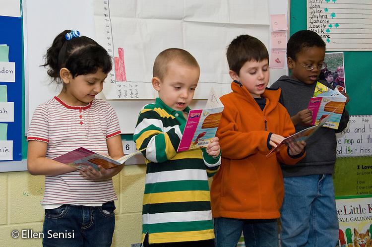 MR / Schenectady, New York. Elmer Avenue School (urban public elementary school). Kindergarten classroom. Students read together as a group in front of class. MR: AH-gKg. ID: AH-gKg. ©Ellen B. Senisi.