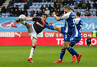 Bolton Wanderers' Joe Williams shoots under pressure from Wigan Athletic's Sam Morsy <br /> <br /> Photographer Andrew Kearns/CameraSport<br /> <br /> The EFL Sky Bet Championship - Wigan Athletic v Bolton Wanderers - Saturday 16th March 2019 - DW Stadium - Wigan<br /> <br /> World Copyright &copy; 2019 CameraSport. All rights reserved. 43 Linden Ave. Countesthorpe. Leicester. England. LE8 5PG - Tel: +44 (0) 116 277 4147 - admin@camerasport.com - www.camerasport.com