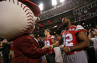 Ohio State defensive lineman Adolphus Washington shakes hands with a Reds mascot prior to the Cincinnati Reds game against Pittsburgh at Great American Ball Park on Wednesday, April 8, 2015. (Columbus Dispatch photo by Jonathan Quilter)