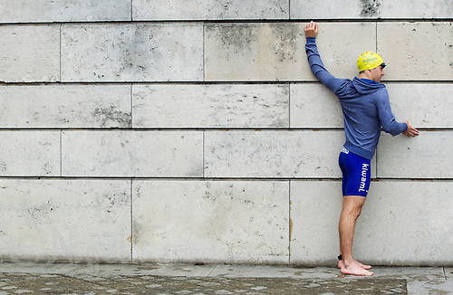 07 JUL 2012 - PARIS, FRA - Aaron Harris (GT Vesoul Haute-Saone) stretches before the start of the elite men's French Grand Prix round during the 2012 Triathlon de Paris at the Pont d'Lena, Paris, France (PHOTO (C) 2012 NIGEL FARROW)