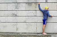 07 JUL 2012 - PARIS, FRA - Aaron Harris (GT Vesoul Haute-Saone) stretches before the start of the elite men's French Grand Prix round during the 2012 Triathlon de Paris at the Pont d'Lena, Paris, France (PHOTO (C) 2012 NIGEL FARROW)