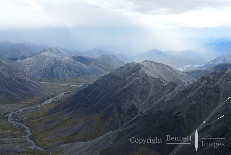 A rainstorm passes over the Brooks Range in Alaska's Arctic National Wildlife Refuge.