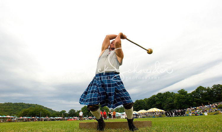 A competitor throws the hammer in the heavy Scottish Athletic Events during the 52nd Annual Grandfather Mountain Highland Games in Linville, NC.