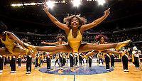 A member of the Johnson C. Smith marching band leaps while performing during the CIAA Tournament  in Charlotte, NC.