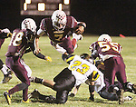 CHAD PILSTER &bull;&nbsp;Hays Daily News<br /> <br /> Osborne High School's Jake Tiernan (7) dives over a defender on Tuesday, November 5, 2013, during the KSHSAA Bi-District Football playoffs at Osborne High School in Osborne, Kansas. Osborne defeated Madison 40-34.