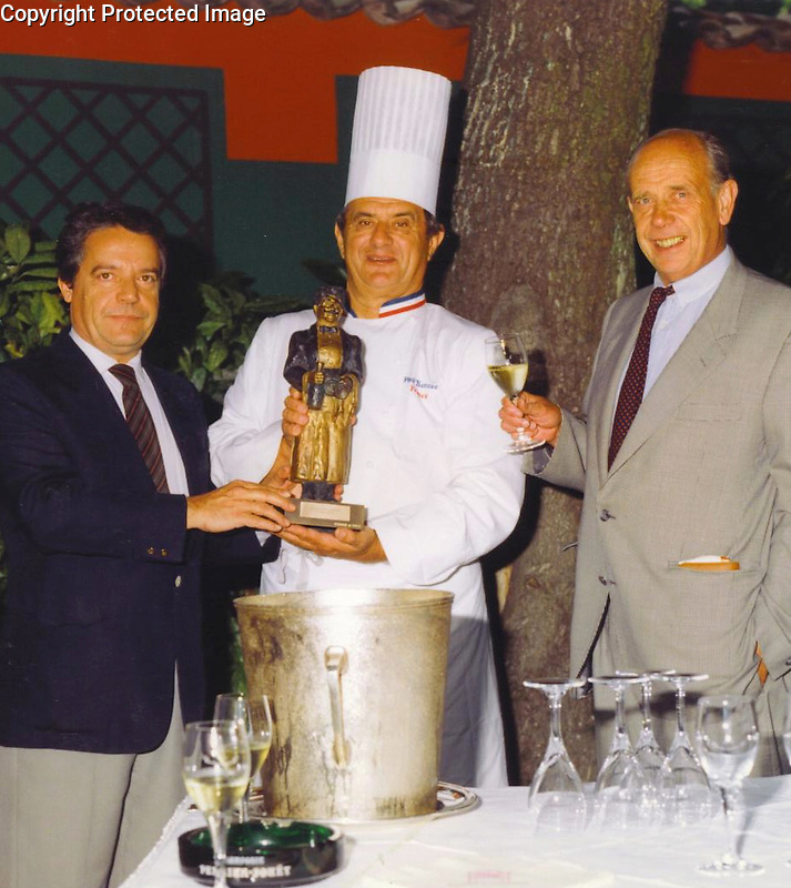 "Guy Buffet, Chef Paul Bocuse and President of Champagne Perrier Jouet, Pierre Ernst, presenting Guy's ""Gaston"" award to the Chef!<br />