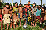 BANGLADESH, District Tangail, Kalihati, village South Chamuria, children with fair trade football / BANGLADESCH, Kinder mit fair trade Fussball