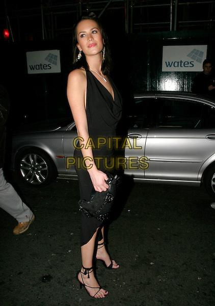 LUCY CLARKSON.OK! Magazine VIP Christmas Karaoke Party at Papageno, London, UK..December 14th, 2005.Ref: AH.full length black dress .www.capitalpictures.com.sales@capitalpictures.com.© Capital Pictures.
