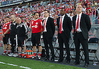 The Toronto FC coaching and training staff during the opening ceremonies in an MLS game between the Seattle Sounders FC and the Toronto FC at BMO Field in Toronto on June 18, 2011..The Seattle Sounders FC won 1-0.