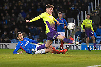 Christian Burgess of Portsmouth left gets a touch to score an own goal to make the score 2-2  during Portsmouth vs Exeter City, Leasing.com Trophy Football at Fratton Park on 18th February 2020