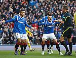 Mervan Celik and Lee McCulloch are enrages as ref Iain Brines chalks off Jig's goal