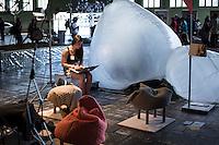 Berlin, Eine Frau sitzt beim DMY International Design Festival, am Freitag (07.06.13) in ehemaligen Flughafen Tegel. Festival findet von Mittwoch (05.06.13) bis Sonntag (09.06.13) statt. Foto: Maja Hitij/CommonLens