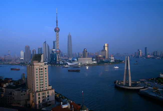 View of Pudong Xinqu (New Area) across Huangpu Jiang (River); near the Bund; evening; Shanghai, China, Asia; 050203