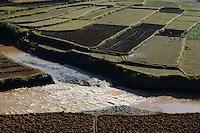 MADAGASCAR, highlands, rice cultivation, farmer till paddy field / MADAGASKAR, Reisfelder im Hochland bei Ambositra, Bauern pfluegen Felder mit Spaten