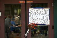 BURLINGTON, WA - SEPTEMBER 24:  A sign displaying community strength hangs on door near community gathering at Maiben Park on September 24, 2016 in Burlington, Washington. Five people were killed last night when a gunman opened fire in the Cascade Mall. (Photo by Karen Ducey/Getty Images)