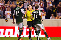 David Horst (12) and Jack Jewsbury (13) of the Portland Timbers argue with referee Jasen Anno after the New York Red Bulls scored their second goal. The New York Red Bulls  defeated the Portland Timbers 3-2 during a Major League Soccer (MLS) match at Red Bull Arena in Harrison, NJ, on August 19, 2012.