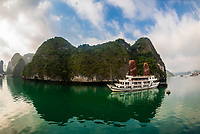 "Aclass Cruises ""Stellar"" cruising in Halong Bay, North Vietnam. The bay features 3,000  limestone and dolomite karsts and islets in various shapes and sizes sprinkled over 1,500 square kilometers. It offers a wonderland of karst topography. It is a UNESCO World Heritage Site."
