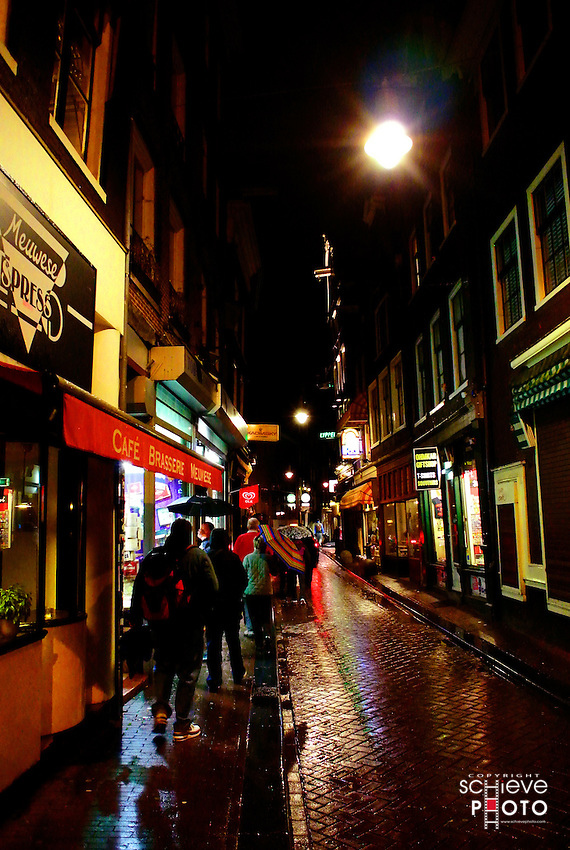 Small downtown Amsterdam street at night.