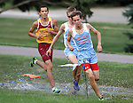 SIOUX FALLS, SD - SEPTEMBER 3: Lincoln's Nathan Schroeder, center, leads teammate Will Lauer and Roosevelt's Jesus Urtusuastegui at the Mack Butler Cross Country Invite Tuesday at Kuehn Park.  (Photo by Dave Eggen/Inertia)