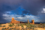 Dramatic clouds over Balanced Rock near sunset in Arches National Park, near Moab, Utah, USA.
