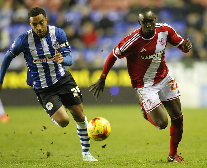 Middlesbrough's Albert Adomah is chased by Wigan Athletic's James Perch<br /> <br /> Photographer Mick Walker/CameraSport<br /> <br /> Football - The Football League Sky Bet Championship - Wigan Athletic v Middlesbrough - Saturday 22nd November 2014 - DW Stadium - Wigan<br /> <br /> &copy; CameraSport - 43 Linden Ave. Countesthorpe. Leicester. England. LE8 5PG - Tel: +44 (0) 116 277 4147 - admin@camerasport.com - www.camerasport.com