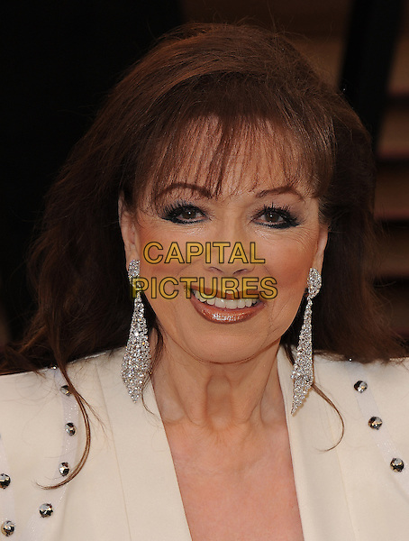 WEST HOLLYWOOD, CA - MARCH 2: Jackie Collins arrives at the 2014 Vanity Fair Oscar Party in West Hollywood, California on March 2, 2014. <br /> CAP/MPI/MPI213<br /> &copy;MPI213 / MediaPunch/Capital Pictures