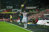 Sunday  14th   December 2014 <br /> Pictured: Neil Taylor of Swansea City throws a ball in fort he Swans <br /> Re: Barclays Premier League Swansea City v Tottenham Hotspur  at the Liberty Stadium, Swansea, Wales,UK