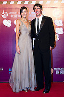 HAIKOU, CHINA - OCTOBER 29:  Michael Phelps (R)  of USA and Hong Kong model Lisa S attend red carpet during day three of the Mission Hills Start Trophy tournament at Mission Hills Resort on October 29, 2010 in Haikou, China.  Photo by Victor Fraile / studioEAST
