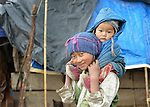 Mingmar Tamang, 10, carries her 11-month old sister Suchita in the village of Gatlang, in the Rasuwa District of Nepal near the country's border with Tibet.<br /> <br /> In the aftermath of the April 2015 earthquake that ravaged Nepal, the ACT Alliance helped people in this village with a variety of services, including shelter and livelihood assistance.<br /> <br /> Parental consent obtained.