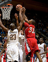 11 November 2009:  Eli Holman of Detroit shoots the ball over California defenders during the game at Haas Pavilion in Berkeley, California.   California defeated Detroit, 95-61.