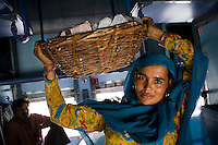 Meena, from Rohtak town, selling Jamun fruits on the Himsagar Express 6318 on 7th July 2009.. .6318 / Himsagar Express, India's longest single train journey, spanning 3720 kms, going from the mountains (Hima) to the seas (Sagar), from Jammu and Kashmir state of the Indian Himalayas to Kanyakumari, which is the southern most tip of India...Photo by Suzanne Lee / for The National