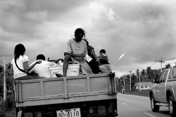 With some difficulty, the coffin is lifted onto the back of a truck. On the way to the burial site, it doubles as a table for things that will be needed at the burial and as a chair for mourners to sit on. The paper thrown into the wind is part of a borrowed Chinese ritual to ensure happiness in the afterlife.<br /> <br /> On April 27, Mrs Mool Klatalay was savagely beaten by her drunken husband. The beating took place in the hovel where Mool lived in a small sea gypsy village in southern Thailand's Phang Nga province. Villagers heard her screams, but no one intervened. No one took her to hospital. She died at home 48 hours later, after losing four pints of blood through internal bleeding. She leaves two sons, aged 19 and 12, and a daughter, aged 3.