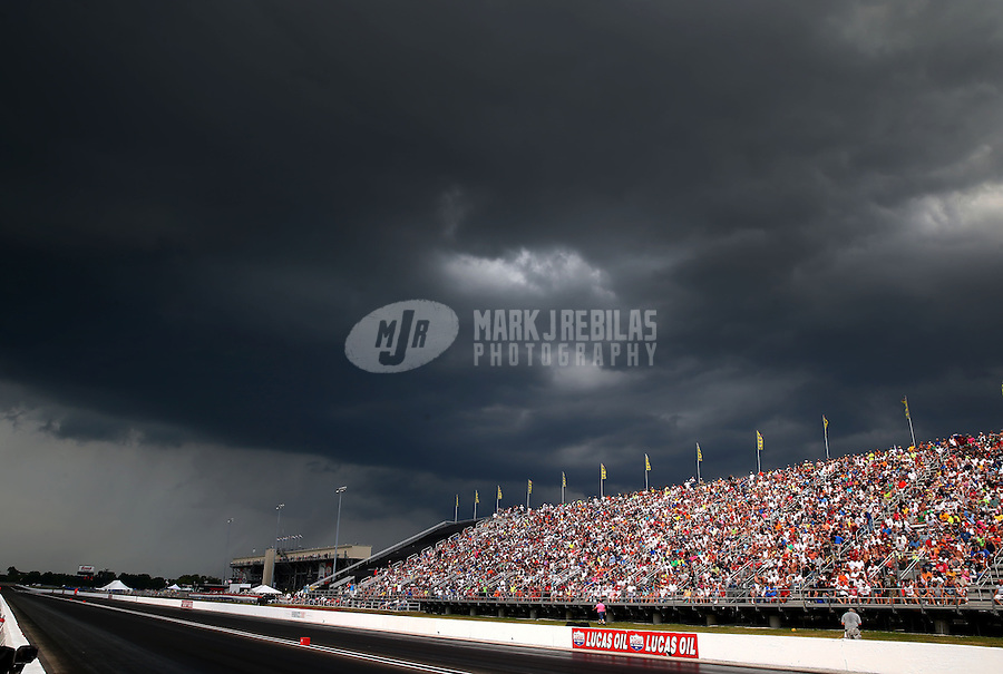 Aug. 31, 2013; Clermont, IN, USA: NHRA fans in the grandstands as storm clouds approach during qualifying for the US Nationals at Lucas Oil Raceway. Mandatory Credit: Mark J. Rebilas-