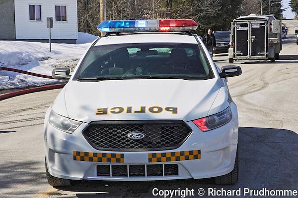 A white Ford Quebec Provincial police car