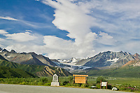 Richardson highway monument, along the Richardson Highway in isabel pass, Gakona Glacier in the distance, Alaska mountain range.