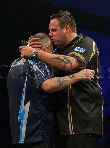 23.04.2015.  Cardiff, Wales. Betway Premier League Darts. Phil Taylor and Adrian Lewis embrace each other before the match.