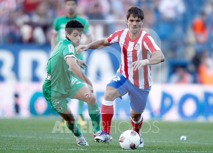 Atletico de Madrid's Diego Ribas against Racing de Santander's Lautaro Acosta during La Liga Match. September 18, 2011. (ALTERPHOTOS/Alvaro Hernandez)